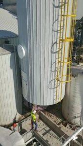 two welding technicians installing a tank