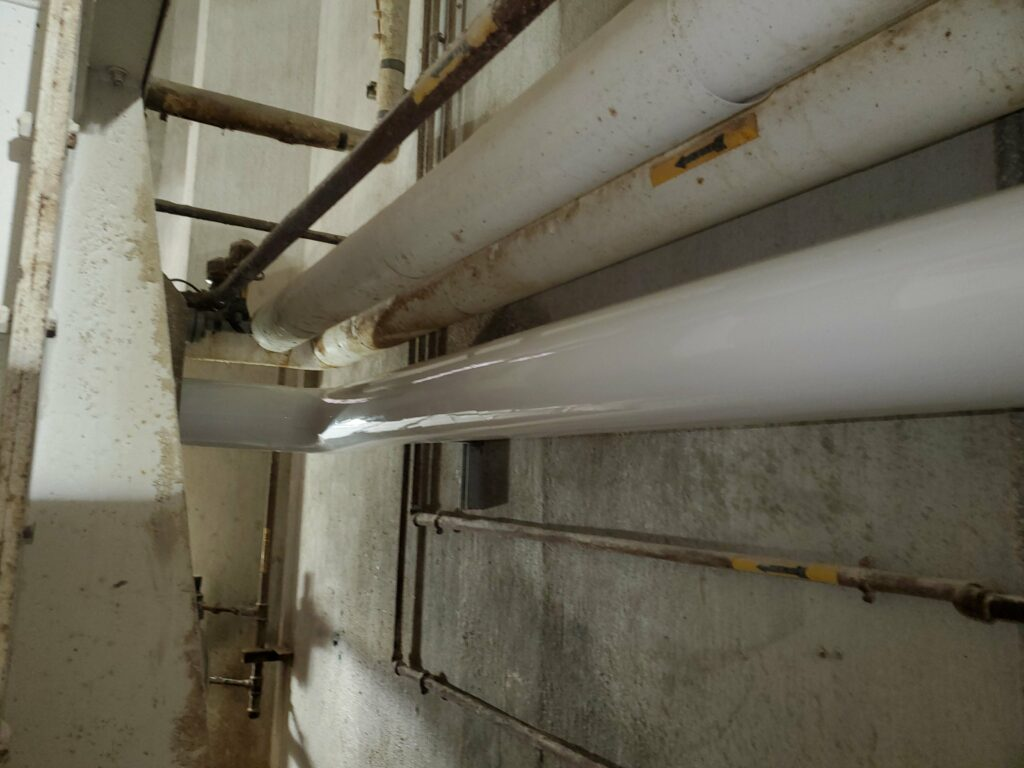 PVC pipe rounding a corner in a feed mill